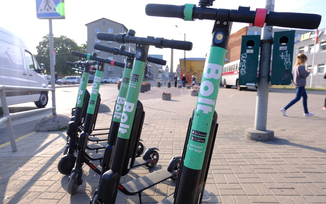 Bolt electric scooters parked in front of Tallinn Bus Station.