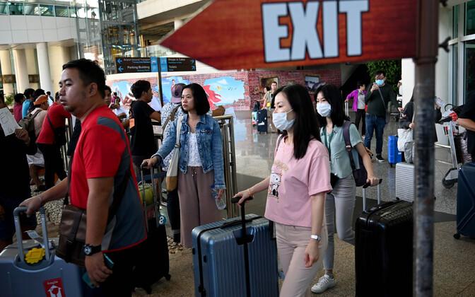Китайские туристы в аэропорту Бали.