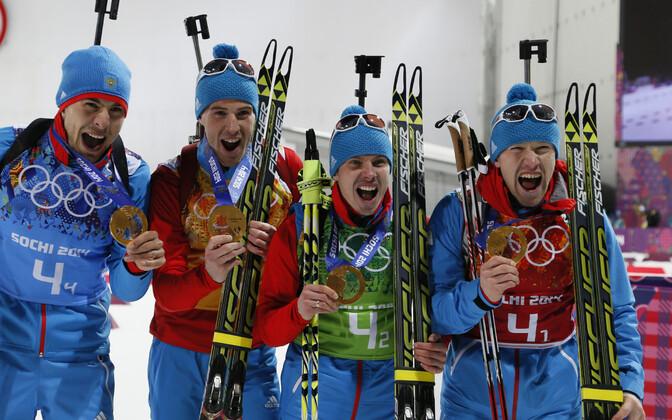 На Олимпийских играх 2014 года Евгений Устюгов (второй слева) выступал в команде с Алексеем Волковым, Дмитрием Малышко и Антоном Шипулиным.
