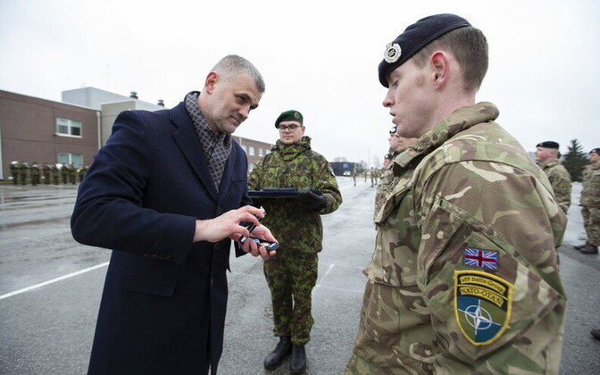 Permanent Secretary Kristjan Prikk of the Estonian defense ministry presenting a British soldier serving as part of the NATO eFP with a service medal at Tapa on Thursday.
