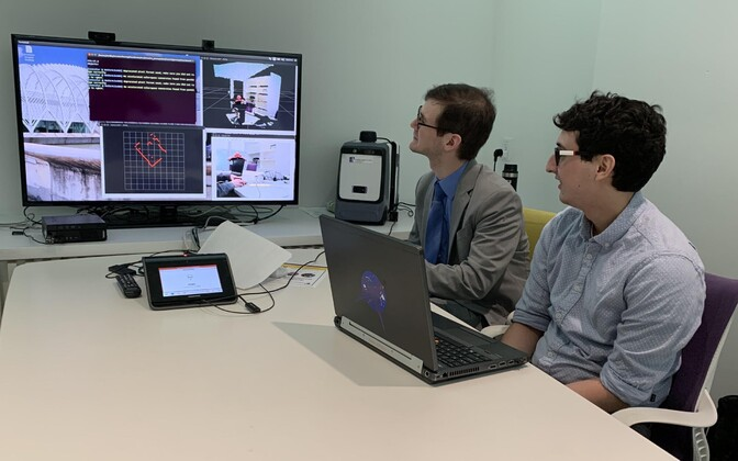 Florida Polytechnic students Chris Medrano and Josh Santos run one of their simulations for autonomous vehicle sensors.