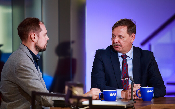 Minister of Economic Affairs and Communications Taavi Aas of the Center Party, at left, with