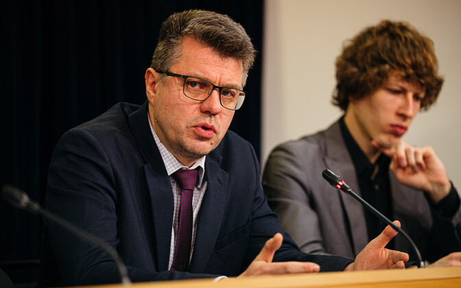 Minister of Foreign Affairs Urmas Reinsalu (Isamaa), with Minister of Social Affairs Tanel Kiik (Center) in the background.