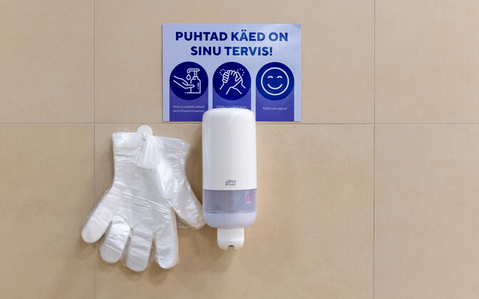 A hand disinfectant station.