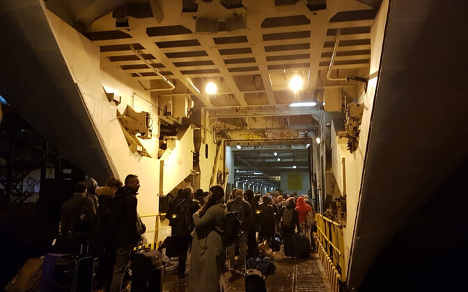 Foot passengers boarding the Romantika via a car deck in Riga Wednesday night.