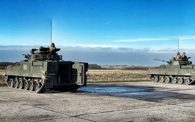 Members of the First Fusiliers using Warrior tracked armored vehicles.