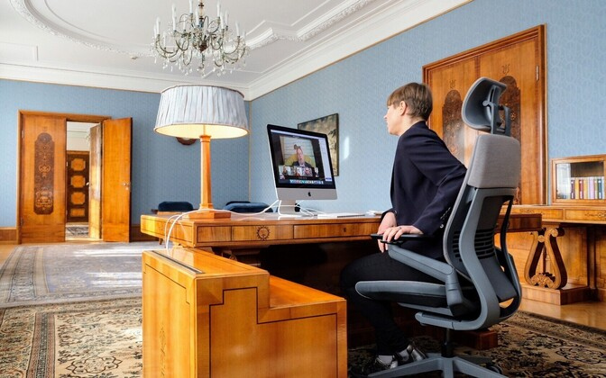 The president holding a virtual visit to Võru County from her office on Thursday.