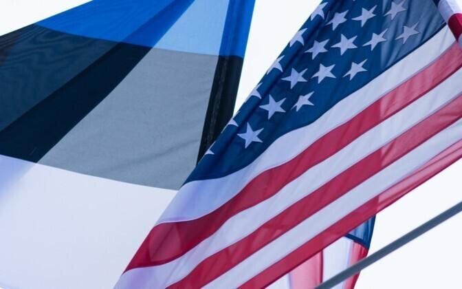 U.S. and Estonian flags.