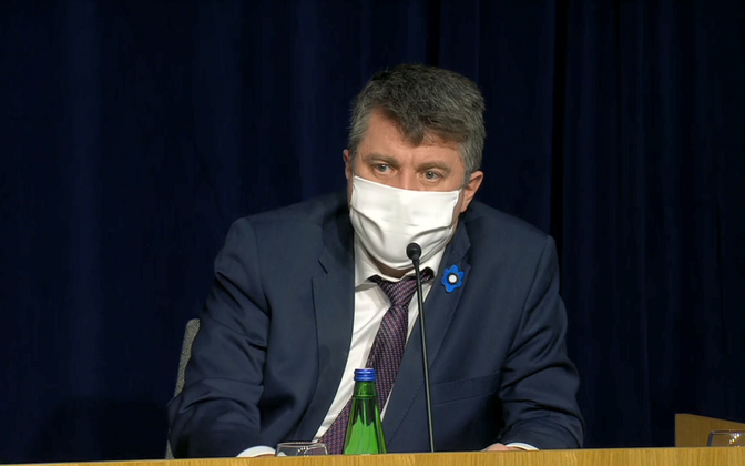 A masked Urmas Reinsalu, Estonia's foreign minister, at a recent government conference.