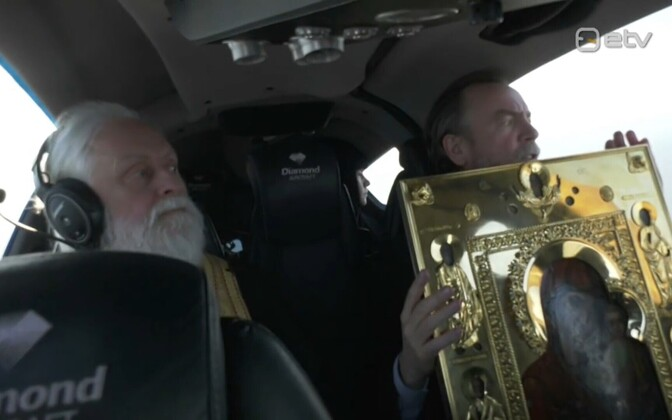 Metropolitan Yevgeny (left) and Bishop Lazar of the Russian Orthodox Church in Estonia, during Wednesday's in-flight stations of the cross procession.