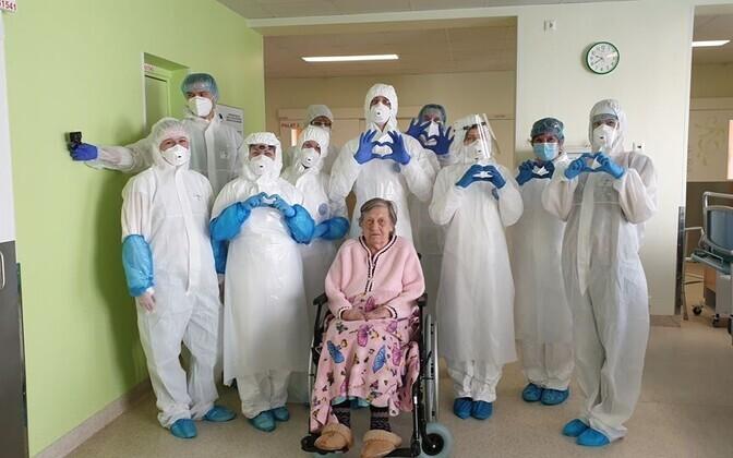 100-year-old Salme Leesi and staff at Kuressaare Hospital.