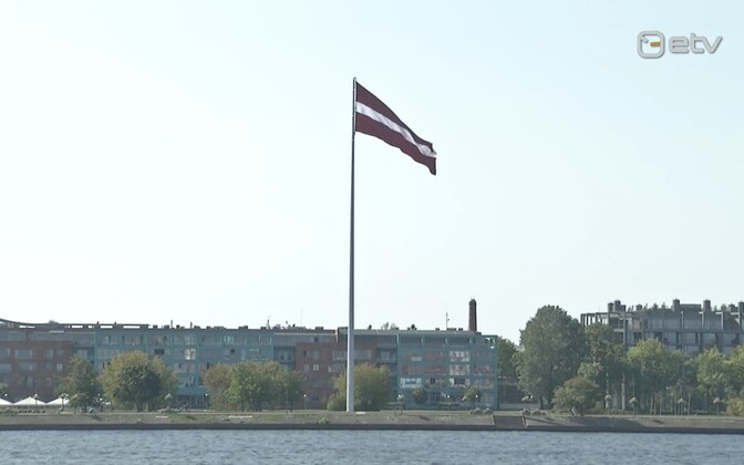 Latvian flag flies over Riga, the capital.