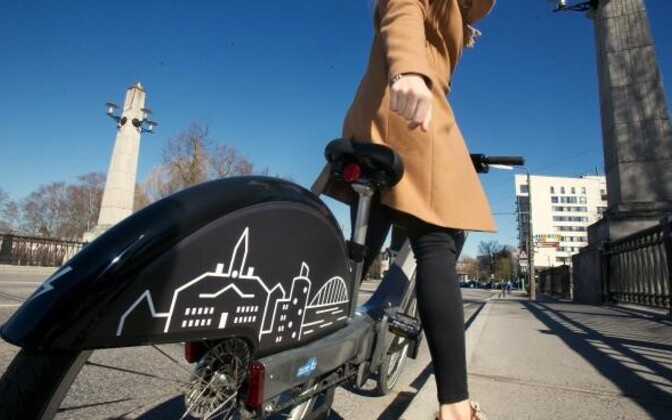 A woman riding a smart bike in Tartu.