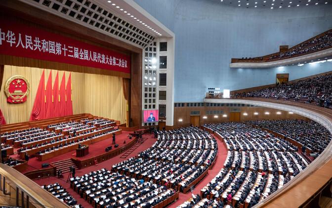 Vahistatud teadlane kutsus Hiina RV parlamenti demokraatiat juurutama. Hiina rahvakongressi suur saal.