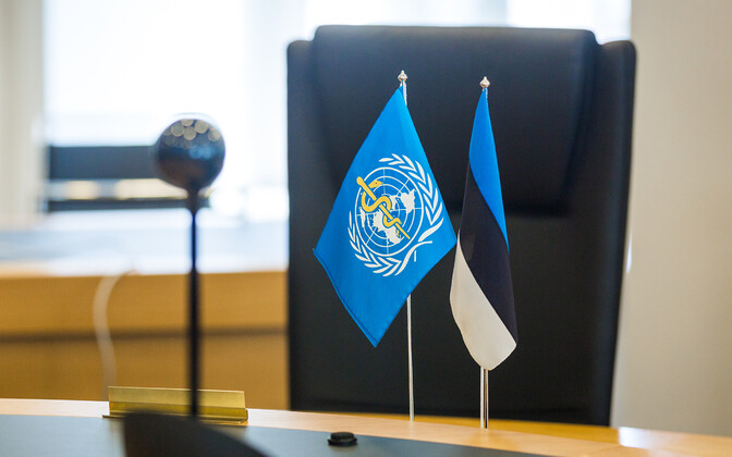 Estonia and World Health Organization  (WHO) flags.