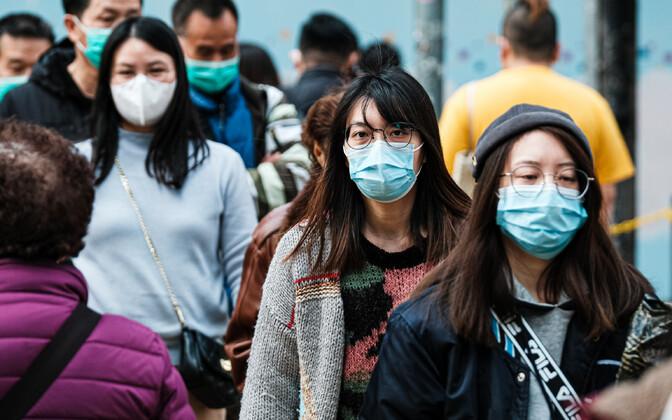 Hiinlased koroonaviiruse tõrjumiseks maske kandmas.
