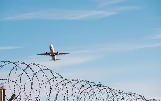 Passenger jet over Tallinn Airport.