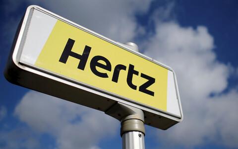 Логотип крупнейшей компании по прокату автомобилей Hertz.