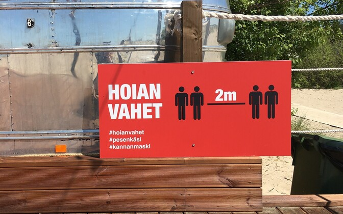 A social distancing sign at Pärnu beach.