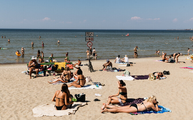 Sunbathers and swimmers on an Estonian beach.