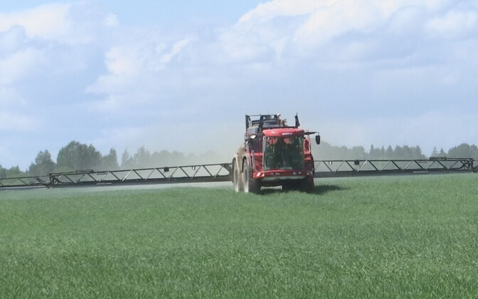 Tractor spraying a field with plant protection products.