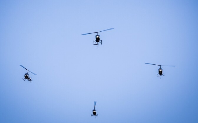 Robinson R44s on a formation flight.