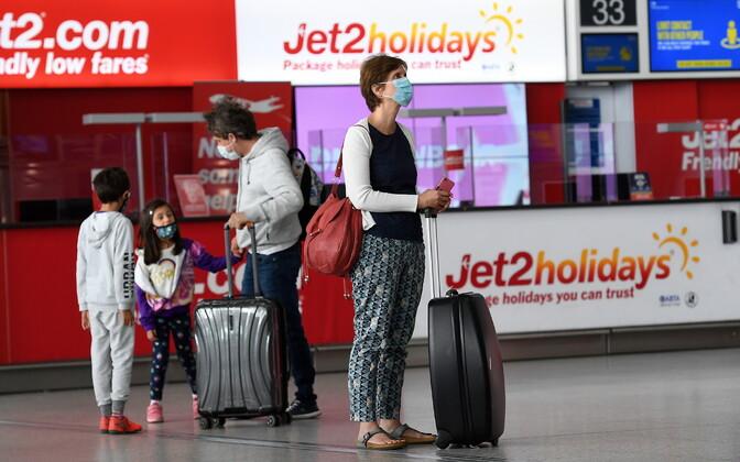 Reisijad Londoni Stansedi lennujaamas.
