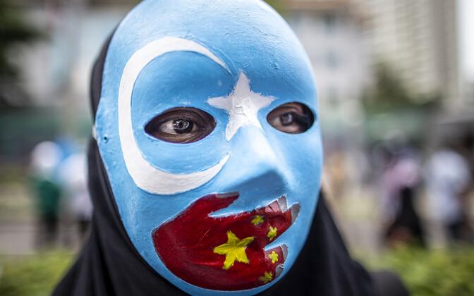 Индонезийский протестующий против притеснения уйгуров.