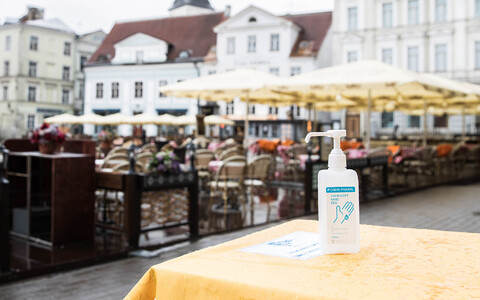 A bottle of hand sanitizer on a table at Raekoja plats in Tallinn's Old Town in May.