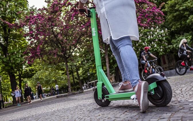 A woman riding a Bolt scooter.