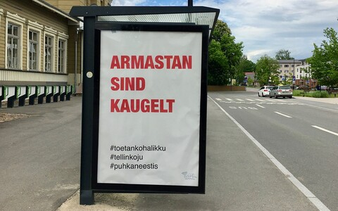 A social distancing sign outside Tartu railway station which translates as