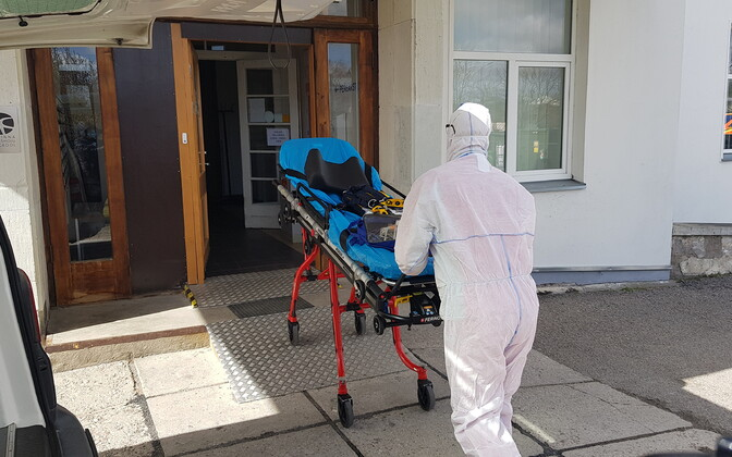 Ambulance worker in protective clothing during the peak of the pandemic so far, in Spring.