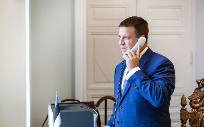Prime Minister Jüri Ratas speaking on the phone.