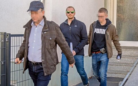 Mark Schmidt (in dark glasses) being arrested last December.