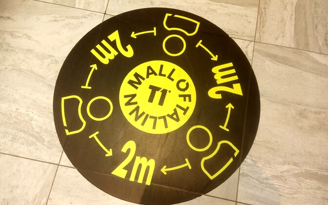 Social distancing sign at T1 Mall in Tallinn.