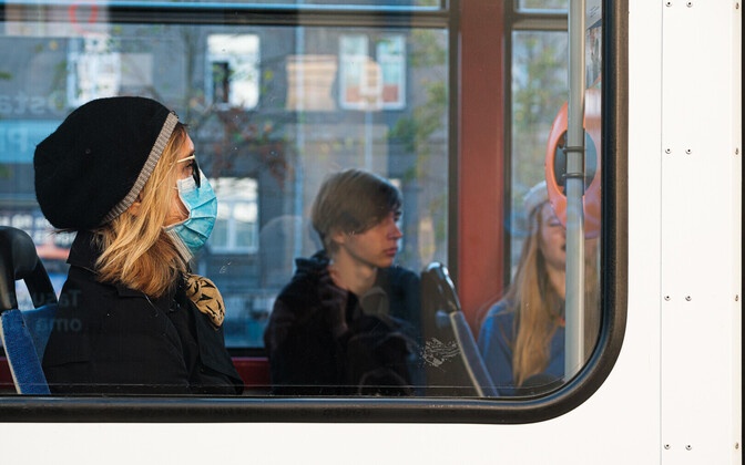 A woman wearing a mask on a tram in Tallinn.