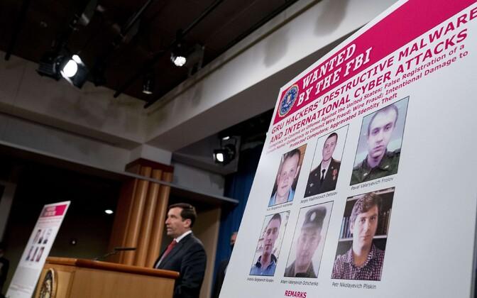 Plakat süüdistused saanud Vene sõjaväeluure liikmetega.