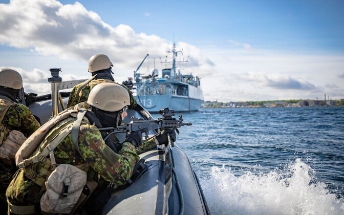 EDF personnel in an inflatable raiding craft on exercise in Tallinn Bay. The Admiral Cowan is in the background.