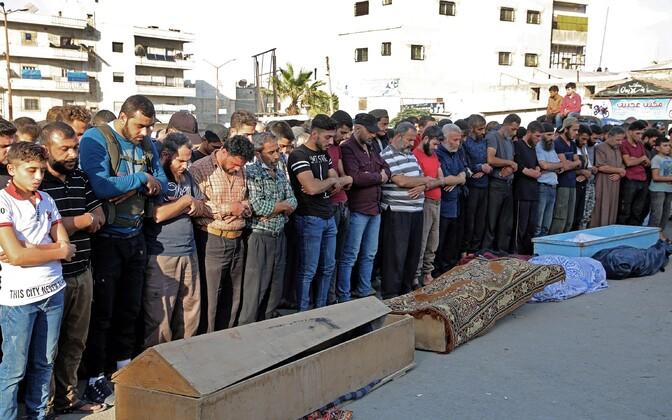 Idlibi süürlased mälestamas Vene õhurünnaku ohvreid rühmitusest Faylaq al-Sham.
