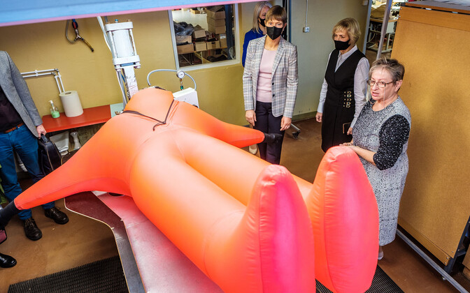 President Kaljluaid during her Viljandi County visit, at Galvi-Linda, a firm which has devised a type of sea survival suit (pictured).