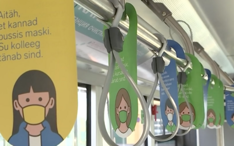 Signs on a Tallinn bus encouraging people to wear masks.
