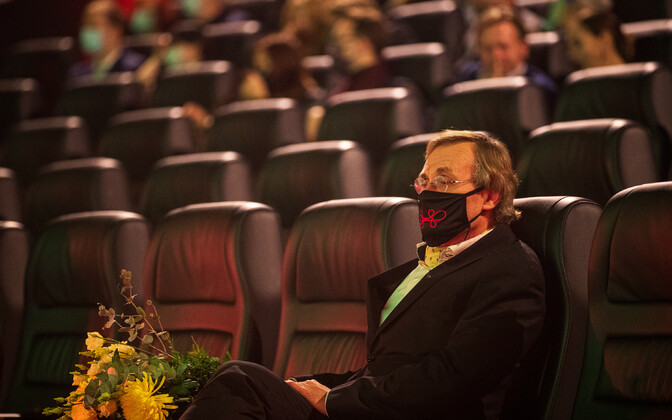 A masked Tõnis Lukas, the culture minister, in a cinema.