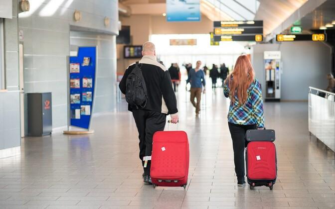 Travelers at Tallinn Airport.