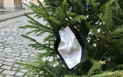 A face mask hung on a Christmas tree in Tallinn.