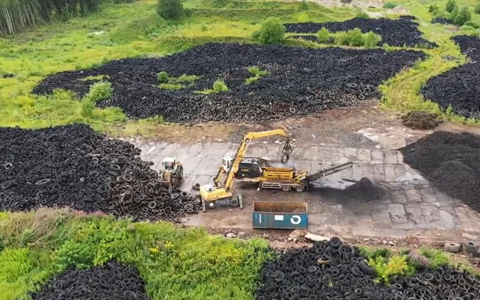Scenes from the Raadi airfield tire dump clean-up.