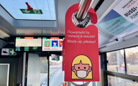 A sign asking passengers to wear a mask on a Tallinn bus.
